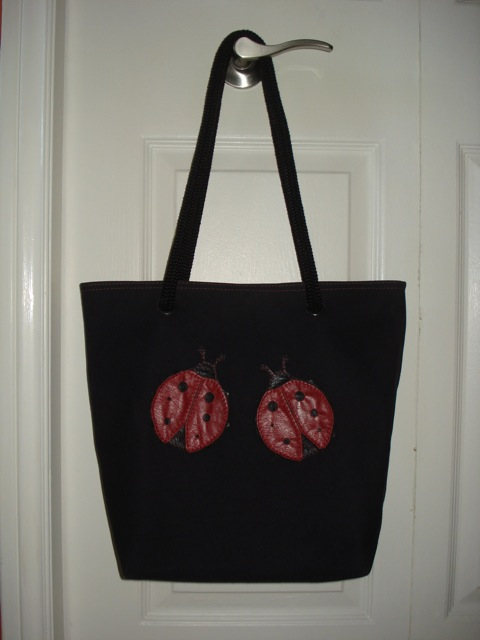 black tote with ladybugs