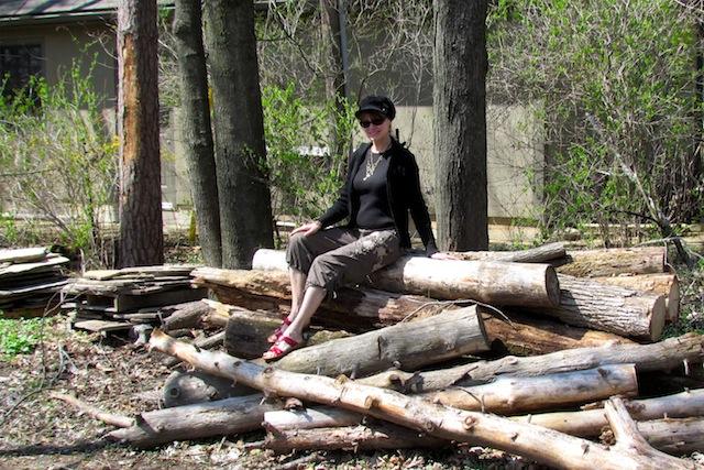 sitting on log