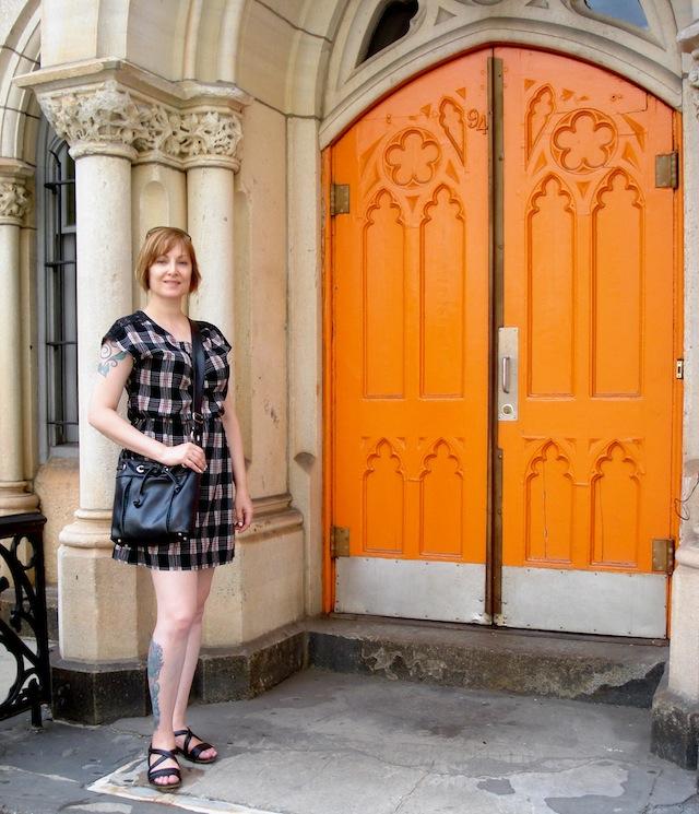 Jean by orange door