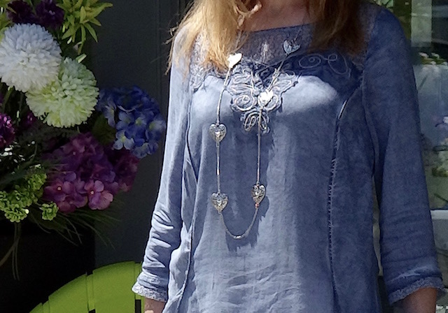 closeup detail of blouse and necklace
