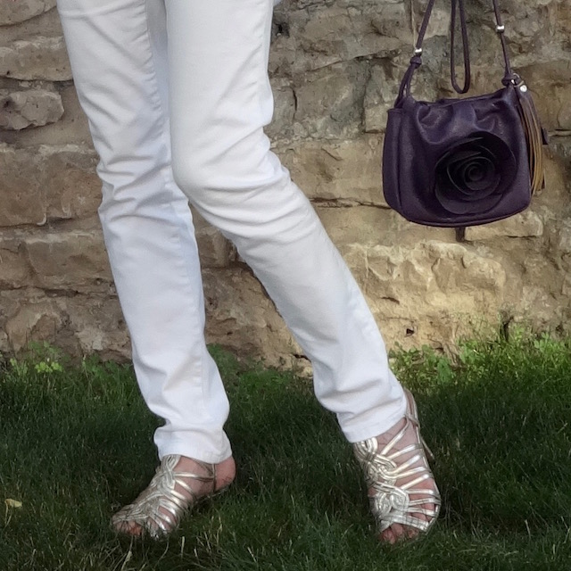 purple flower purse and metallic sandals