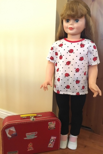 doll and suitcase